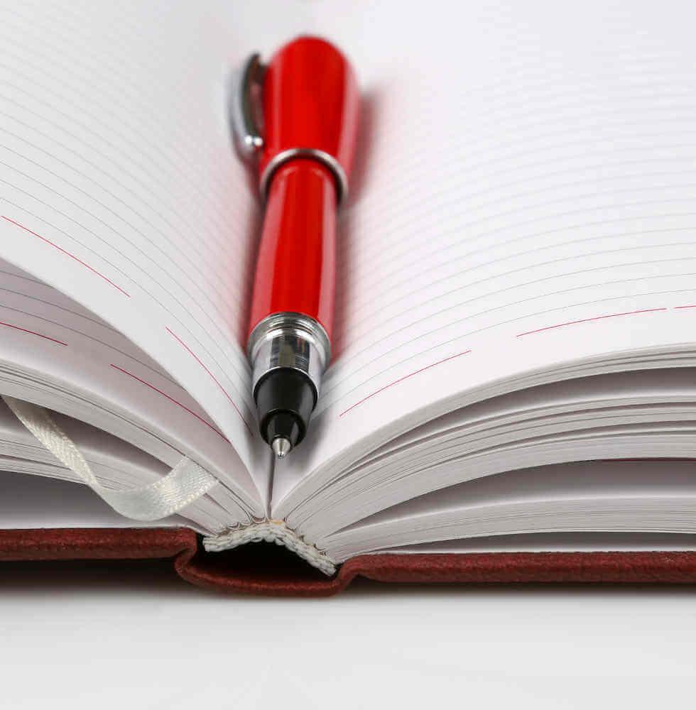 Notizbuch mit rotem Stift – Termine mit Hermann Häfele lohnen sich